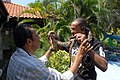 US Navy 081031-N-1635S-004 Yeoman Seaman Darnell Poage, from Chesapeake, Va., visits a snake charmer during a tour to Sentosa Island.jpg