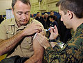 US Navy 081112-N-5345W-002 Capt. Alan Labeouf, assigned to U.S. Fleet Forces Command, receives his annual flu vaccination.jpg