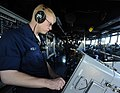 US Navy 090523-N-5345W-329 Operations Specialist Seaman Nicholas Kelly mans the ANSPA 25G radar station in the pilothouse of the amphibious dock landing ship USS Fort McHenry (LSD 43).jpg