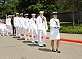 US Navy 090710-N-1325N-003 Hospital Corpsman 3rd Class Ashley Stone carries the retirement flag for her father, Capt. James Stone.jpg