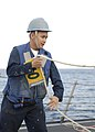 US Navy 091116-N-9520G-064 Logistic Specialist 3rd Class Charles Edison Rostro, slacks the phone and distance line during an underway replenishment.jpg