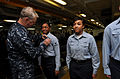 US Navy 100106-N-8273J-218 Chief of Naval Operations (CNO) Adm. Gary Roughead pins Enlisted Aviation Warfare Specialist pins on Sailors during a ceremony aboard the aircraft carrier USS Nimitz (CVN 68).jpg