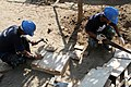 US Navy 100301-M-2451B-023 Members of the Philippine Navy 2nd Mobile Construction Batallion use scrap wood to build trays for stucco for the Teppeng Elementary School.jpg