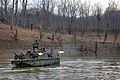 US Navy 100324-N-3136P-212 A riverine assault boat assigned to Riverine Squadron (RIVRON) 1 provides cover while Riverine Security Team takes control of the shore during a six-day field exercise at Ft. Knox, Ky.jpg