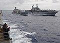 US Navy 100810-N-1082Z-032 Sailors aboard the amphibious dock landing ship USS Ashland (LSD 48) watch the Military Sealift Command fleet replenishment oiler USNS Leroy Grumman (T-AO 194) conduct a replenishment at sea.jpg