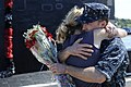US Navy 100827-N-8467N-004 Machinist's Mate 1st Class Terence Holcomb hugs his wife moments after USS Annapolis (SSN 760) returned to Submarine Base New London.jpg