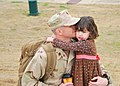 US Navy 110131-N-3285S-007 Lt. Cmdr. Matthew Reed says goodbye to his daughter at the Training Hall at the Naval Construction Battalion Center befo.jpg