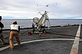 US Navy 110224-N-RC734-346 Guy Mcallister, from Insitu Group, launches the first Scan Eagle unmanned aerial vehicle from the flight deck of the amp.jpg