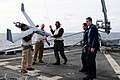 US Navy 110226-N-RC734-103 Members of the Scan Eagle team remove a Scan Eagle unmanned aerial vehicle from the Skyhook arrested recovery system aft.jpg