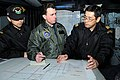 US Navy 110313-N-IC111-007 Capt. Jim Morgan, middle, commander of Destroyer Squadron 7, coordinates search and rescue efforts with Japan Maritime S.jpg