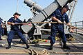 US Navy 110906-N-DU438-016 Fire Controlman 2nd Class Lindsey Ewald, left, and Fire Controlman 3rd Class Aaron Hawkins heave a line during sea and a.jpg
