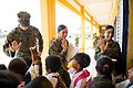 US Navy 111215-M-IS773-019 Marines assigned to the logistics combat element of the 11th Marine Expeditionary Unit high-five Cambodian students leav.jpg