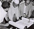 U Nu from Burma studies a torah scroll. D777-118.jpg