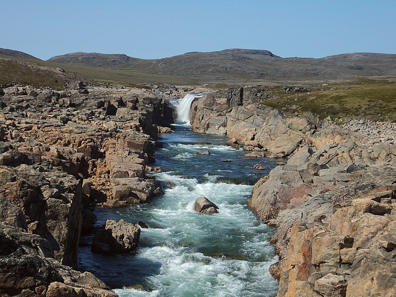stony river and waterfall at Ukkusiksalik National Park, place in Nunavut
