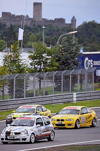 Veranstaltergemeinschaft Langstreckenpokal Nürburgring - Touring cars passing in front of the Nürburg