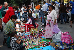 English: Vendor selling craft dolls and other ...