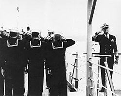 Vice Admiral Lynde D. McCormick (USN) boards USS Columbus (CA-74) on 20 September 1952 (80-G-447768)