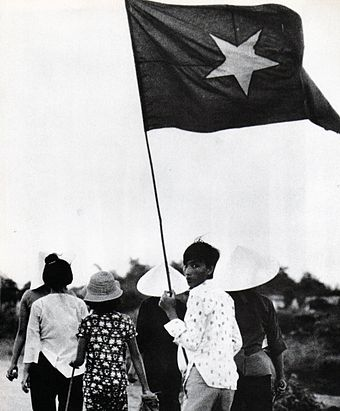 Civilians in a NVA/Viet Cong controlled zone. Civilians were required to show appropriate flags, during the War of the flags Vietcong people.jpg