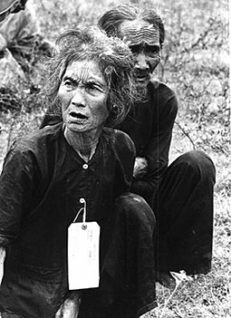 Peasants suspected of being Viet Cong under detention of U.S. Army, 1966 Vietnamese villagers suspected of being communists by the US Army - 1966.jpg