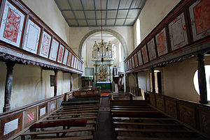 Viscri fortified church - The hall church interior with its wooden gallery