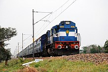 Blue diesel locomotive hauling a passenger train