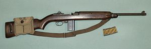 .30 Carbine - WW II M1 Carbine with a magazine pouch mounted on the stock that held two spare 15-round magazines and 10 .30 Carbine rounds on stripper clip.