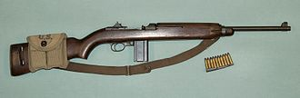.30 Carbine - WW II M1 carbine with a magazine pouch mounted on the stock that held two spare 15-round magazines and 10 .30 Carbine rounds on a stripper clip