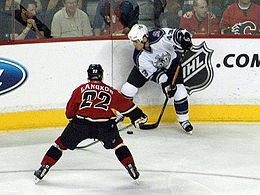 Los Angeles Kings' Mike Weaver battling for the puck against Calgary Flames' Daymond Langkow, December 21, 2005.