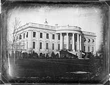 A black and white image of the White House
