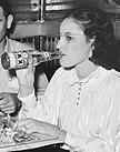 Woman drinking Jax Beer in 1938 at Raceland Crab Boil by Rusell Lee (cropped).jpg