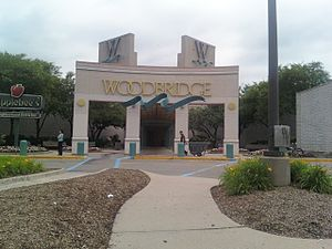 Woodbridge Center - An entrance to the Center; The four W towers face the four compass directions, with the ones most prominent in the picture being west and south.