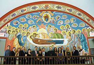 """Macedonian Orthodox Cathedral of the Dormition of the Virgin Mary (Reynoldsburg, Ohio) - """"Dormition of the Most Holy Birthgiver of God"""" fresco  on the western wall of the Cathedral, completed 2010, donated by the MOPS of Columbus; some of its members present on the photograph together with the zograf (fresco-painter) Fr. Theodore Jurewicz"""