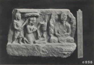 Relief with monk meditating at the right, and on the left, half of a skeleton, a kneeling crowned figure and a second figure holding a parasol above the crowned figure