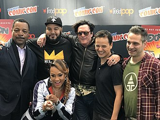 El Rey Network - El Rey correspondent Chuey Martinez (in the hat) posing with the cast and crew of Explosion Jones at the 2017 New York Comic Con