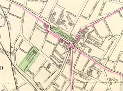 A map of downtown Waterbury on cream-colored paper, with main through streets traced in pink and the parks filled in with green