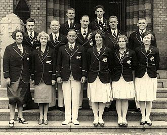 New Zealand at the 1928 Summer Olympics - The New Zealand team in 1928 including supporters; front (l–r): Annie Miller (chaperone), Mrs Amos (chaperone), Harry Amos (Chef de Mission), Ena Stockley, Kathleen Miller, Norma Wilson middle: Ted Morgan, C. Dickinson (masseur), Arthur Porritt, David Lindsay, Alf Cleverley back: Len Moorhouse, Stan Lay