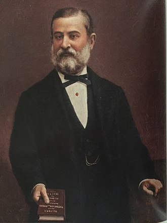 Antonio Annetto Caruana - A.A. Caruana holding his Report on the Phoenician and Roman Antiquities in the group of islands of Malta (1888)