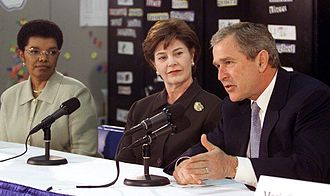 Timeline of the presidency of George W. Bush - President George W. Bush talks to an education roundtable with Laura Bush and Rosa Smith, Superintendent of the Columbus School district at Sullivant Elementary School in Columbus, Ohio on February 20, 2001.