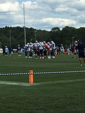 2015 New England Patriots season - Tom Brady gets in the huddle at the 2015 Patriots Training Camp