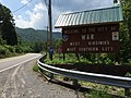 """2017-07-22 12 09 09 """"Welcome to the City of War"""" sign along southbound West Virginia State Route 16 (Main Street) at Excelsior A Road (McDowell County Route 102-08) in War, McDowell County, West Virginia.jpg"""