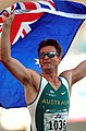 261000 - Athletics track 4x100m T46 Neil Fuller Australian flag - 3b - 2000 Sydney race photo.jpg