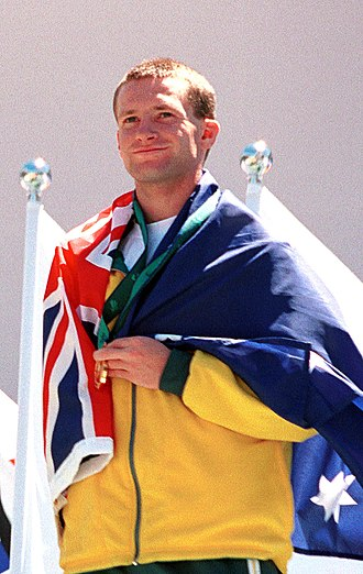 Heath Francis - Francis shown wrapped in the Australian flag and holding his gold medal won in the Men's 4 x 100 m T46 relay at the 2000 Summer Paralympic Games