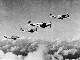 VII Fighter Command - North American P-51D-20-NA Mustangs from the 45th Fighter Squadron, 15th Fighter Group flying a B-29 escort mission from Central Field, Iwo Jima, June 1945. Serials 44-63325 44-63314 44-63474 44-63428 identifiable.