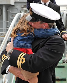 A Royal Navy Officer Hugs His Daughter After Returning from a Long Deployment on HMS Chiddingfold MOD 45153053.jpg