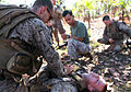 A U.S. Marine, left, with Lima Company, 3rd Battalion, 3rd Marine Regiment, Marine Rotational Force-Darwin treats a simulated casualty during a squad competition at Kangaroo Flats Training Area, Northern 130523-M-AL626-0956.jpg