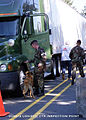 A US Army (USA) military policeman (MP) and his explosive detection dog, inspect commercial vehicles at the Logistic Center inspection point, Fort Lewis, Washington, following the September 11th terrorists 010912-A-ZI320-009.jpg