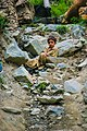 A boy watching people pass through land slides on the way to Hunza.jpg
