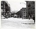 A firefighter stands in a snow filled street (13887847282).jpg