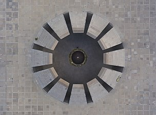 A girl putting flowers to Armenian Genocide memorial. View from top.jpg