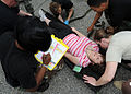 A medical team from the 440th Medical Squadron responds to a victim of a mass casualty exercise.jpg